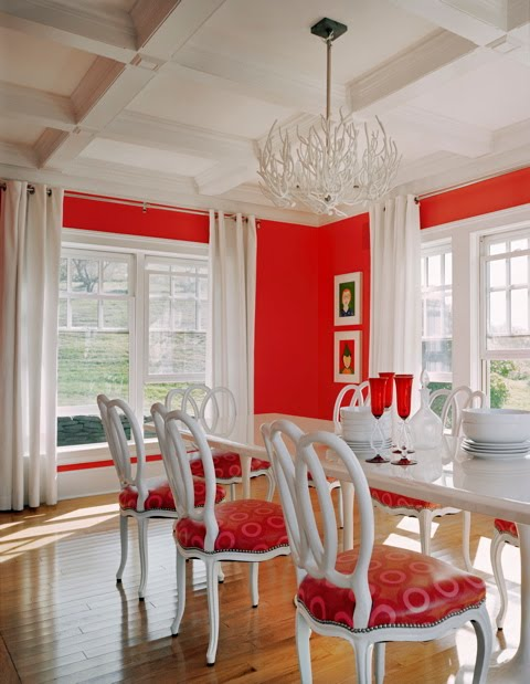 Red and white dining room by Ghislaine Vinas with coffered ceiling and red walls