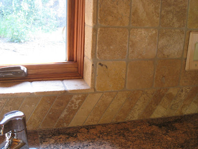 Honed limestone backsplash