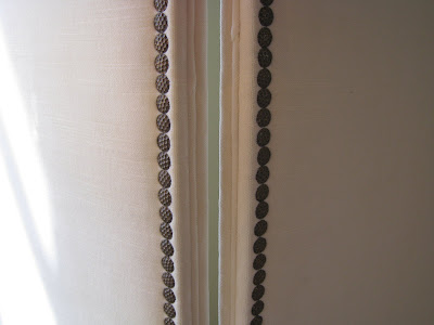 Close up of the nail head trim on a three panel upholstered screen