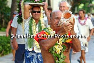 Hawaiian man blowing the conch shell
