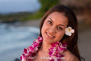 Hawaiian girl with orchid flower lei