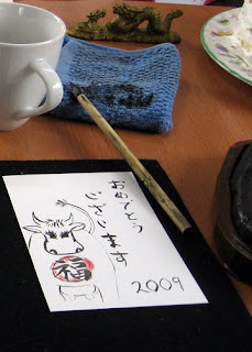 New Year card I made in calligraphy class for the Year of the Ox -- it says omedetou gozaimasu!