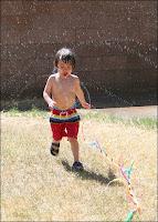 Liam enjoying the sprinkler