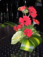 Red gerbera with iron leaves