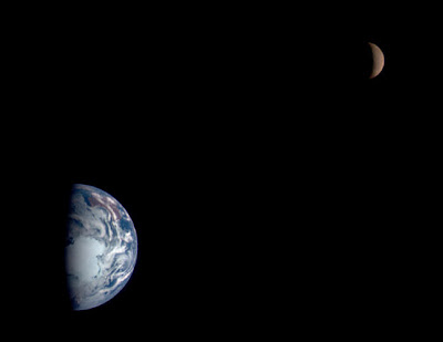 Earth & Moon 26 Jan 98  This mosaic shows images of Earth and the moon acquired by the  multispectral imager on the Near Earth Asteroid Rendezvous Spacecraft  (NEAR) on January 23, 1998, 19 hours after the spacecraft swung by Earth  on its way to the asteroid 433 Eros. The images of both were taken from  a range of 250,000 miles (400,000 kilometers), approximately the same as  the distance between the two bodies.