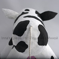 Paper-mache cow. Rear view