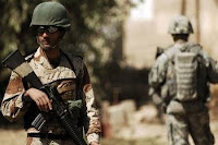 An Iraqi Army soldier provides security alongside U.S. Army Soldiers during a dismounted patrol in Abu Atham, Iraq. Improved Iraqi Security Forces are considered one key reason for the improved security throughout Iraq. (Air Force photo by Tech Sgt. William Greer)