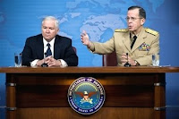 Defense Secretary Robert M. Gates and Navy Adm. Mike Mullen, chairman of the Joint Chiefs of Staff, address the media during a press conference at the Pentagon Wednesday.