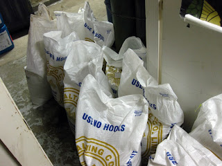 I didn't have any hombrew store shots, so here are some sacks of malt at a brewery...