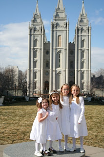 4 sisters posing in front of a church