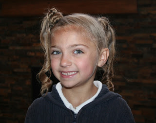 Portrait of young girl modeling Triple-Bun Ponytails {Tri-Bun-Onies} | Cute Hairstyles