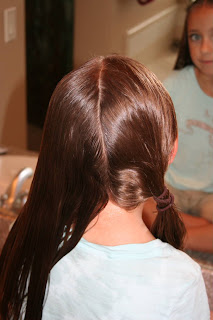 "Back view of girl's hair being styled in ""Criss-Cross French Braids"""