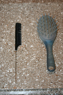 Rat's tooth comb and Goody Ouchless brush