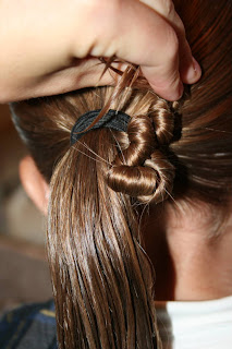 """Young girl's hair being styled in to """"Ponytail Of Twists"""" hairstyle"""