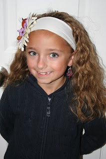 Portrait of Young girl' modeling 2nd Day Curls from Double-French Braids
