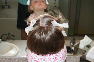 """Back view of young girl modeling """"Two Messy Twists on Top"""" Hairstyle"""