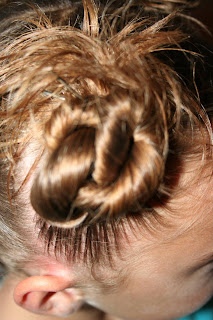 "Side view of young girl modeling ""4 Messy-Pigtail Twists"" hairstyle"