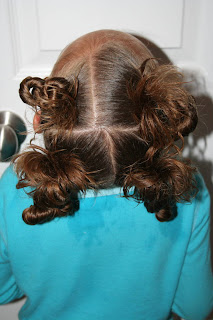 "Back view of young girl modeling ""4 Messy-Pigtail Twists"" hairstyle"