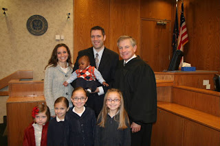 A photo of the whole family at the courthouse.