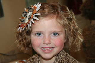 Portrait of young girl modeling 3-barrel curl hairstyle on her a-line bob