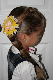 "Side view of young girl modeling ""Top-Knot with Banded"" Ponytail"