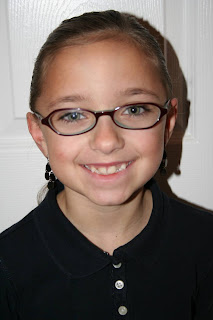 "Portrait of Young girl modeling ""Flip Braided Heart"" hairstyle"