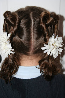 """Back view of a young girl modeling """"Two Hearts Twist"""" hairstyle"""