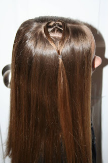 "Side view of young girl modeling ""teen heart"" hairstyle 1"