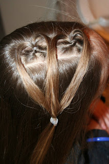 "Top view of young girl having her hair styled as ""teen heart"" hairstyle 2"