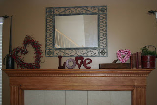 Valentine's Day themed decor around the fireplace mantle
