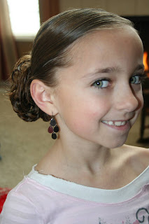 "Side view of young girl modeling ""bundled braids"" hairstyle"