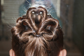 "Back view of young girl modeling ""Three-Leaf Clover Twists"" hairstyle"