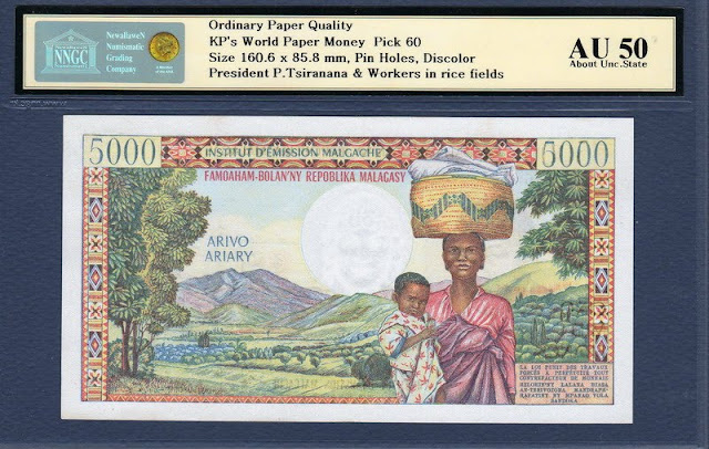 Madacascar currency banknotes 5000 Francs 1000 Ariary Central Bank of Madagascar Village Huts Banque Centrale Woman with baby and basket on Her head