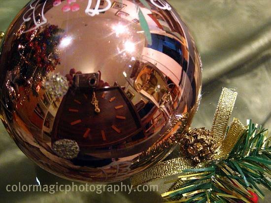 Clock reflected in a Christmas bauble