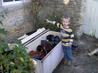 dead fridge full of used plant pots