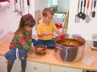 serving out a cauldron of tomato soup