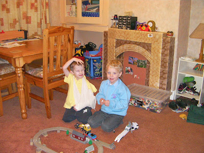 schoolboys playing lego and wooden train track from tesco
