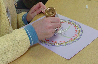 A participant works on a mandala art project