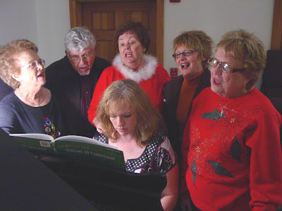 singing carols at the piano