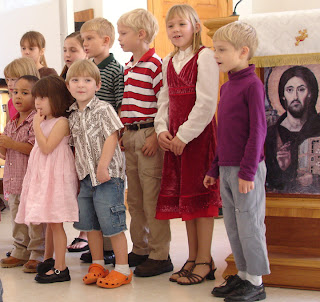 kids singing in worship at King of Peace January 2007