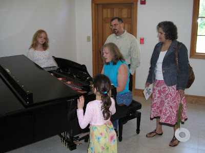 Debbie leading a group singing after worship