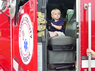 Gray in a fire truck