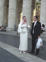 A bride and groom waiting to see the pope