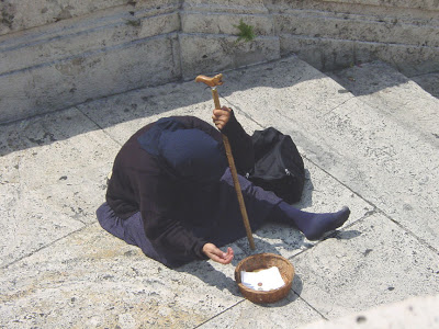 Beggar on the Spanish Steps in Rome