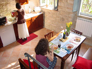 Victoria cooking in 'our' apartment in Todi, Italy