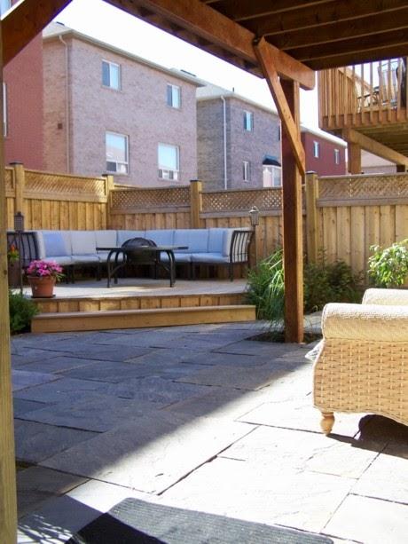 Landscape Designer: Small urban backyard turned into