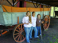 Girls in from of the Wagon I have picture of ME at 8 yrs old in front of!