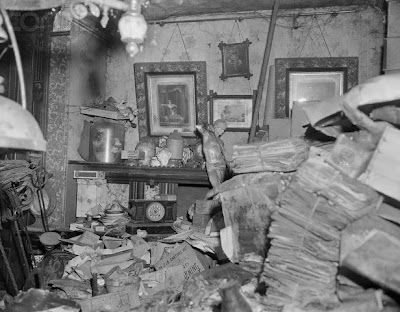 Clutter Filled Room in the Collyer House —  — Room in house of Langley and Homer Collyer, well known eccentric and reclusive brothers who were found dead in 1947 in their Fifth Avenue, New York City brownstone buried amid 180 tons of junk. —  — Corbis