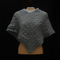This light blue poncho style capelet is made with recycled yarn.  Click here for a better view!