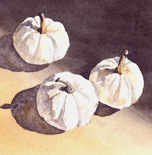 Three White Pumpkins